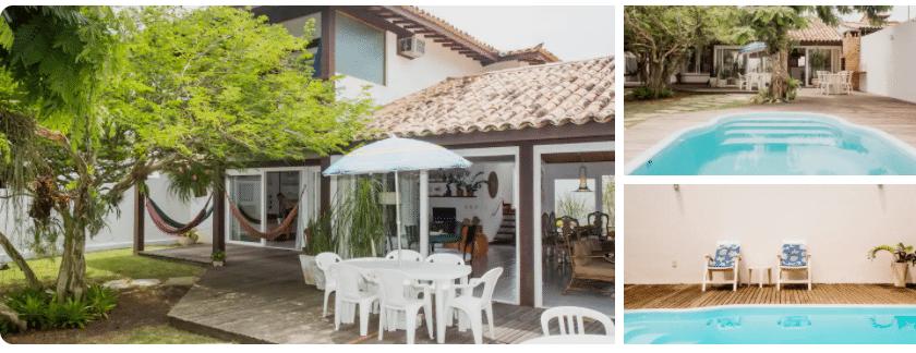 Varanda com mesa e cadeira e rede e piscina de Casa com piscina para alugar em Búzios
