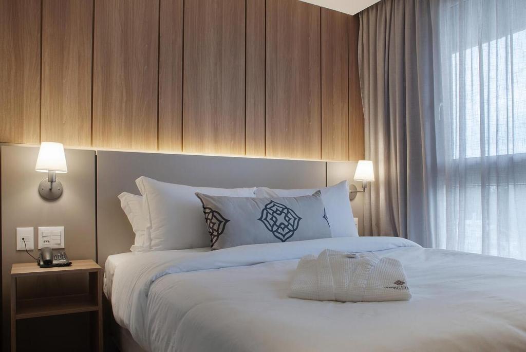 Quarto de hotel em Gramado com cama